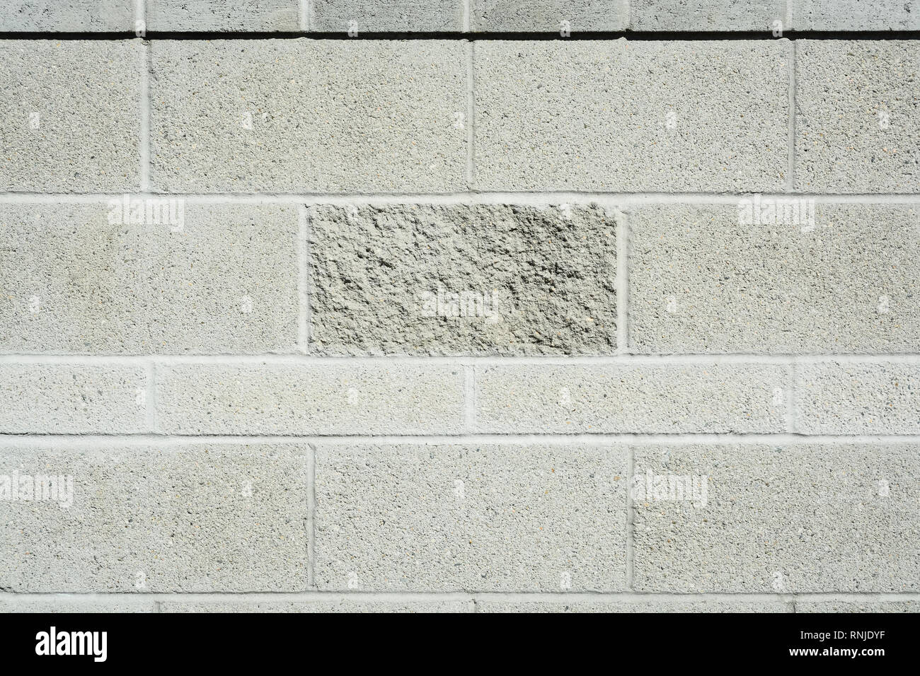 Stone wall concrete texture. Cement block wall background Stock Photo