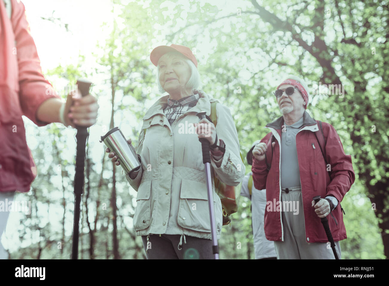 Couple of seniors hiking using the special staff - Stock Image