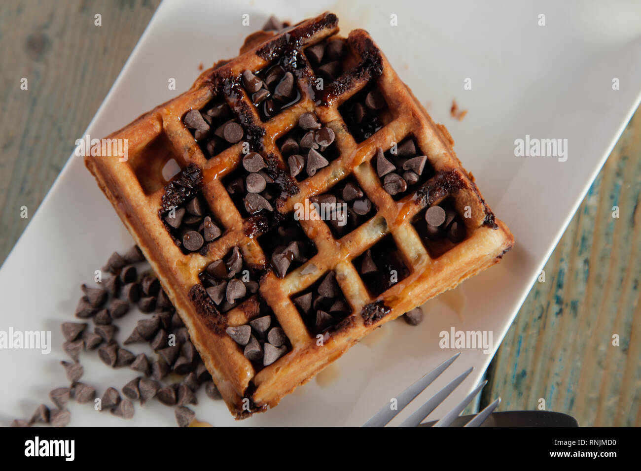 Closeup Chocolate Chip Waffle with whipped cream - Stock Image