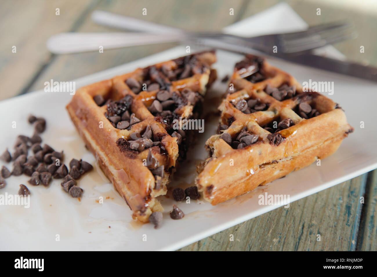 Chocolate chip waffle cut into half - Stock Image