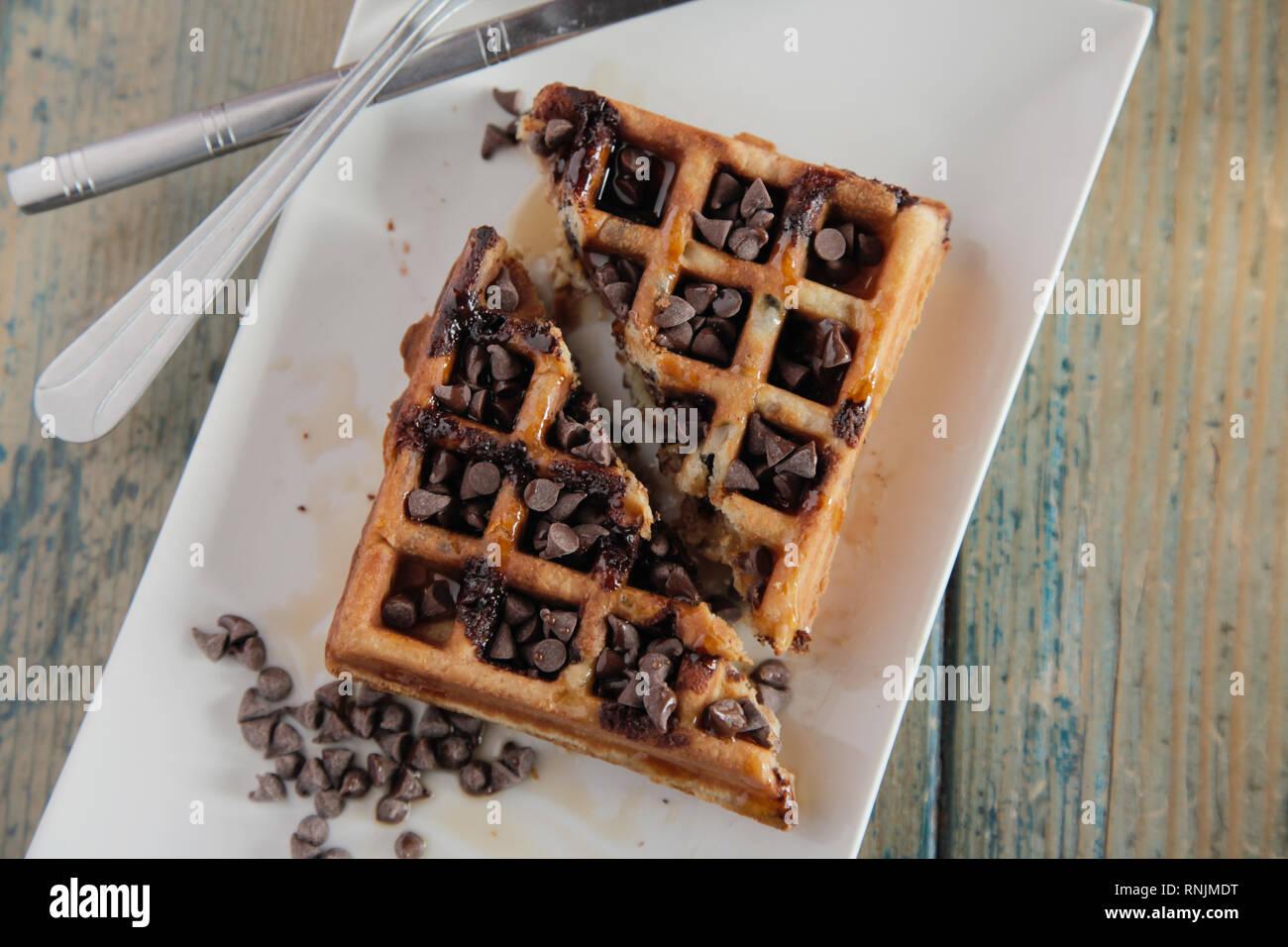 Top angle of chocolate chip waffle - Stock Image