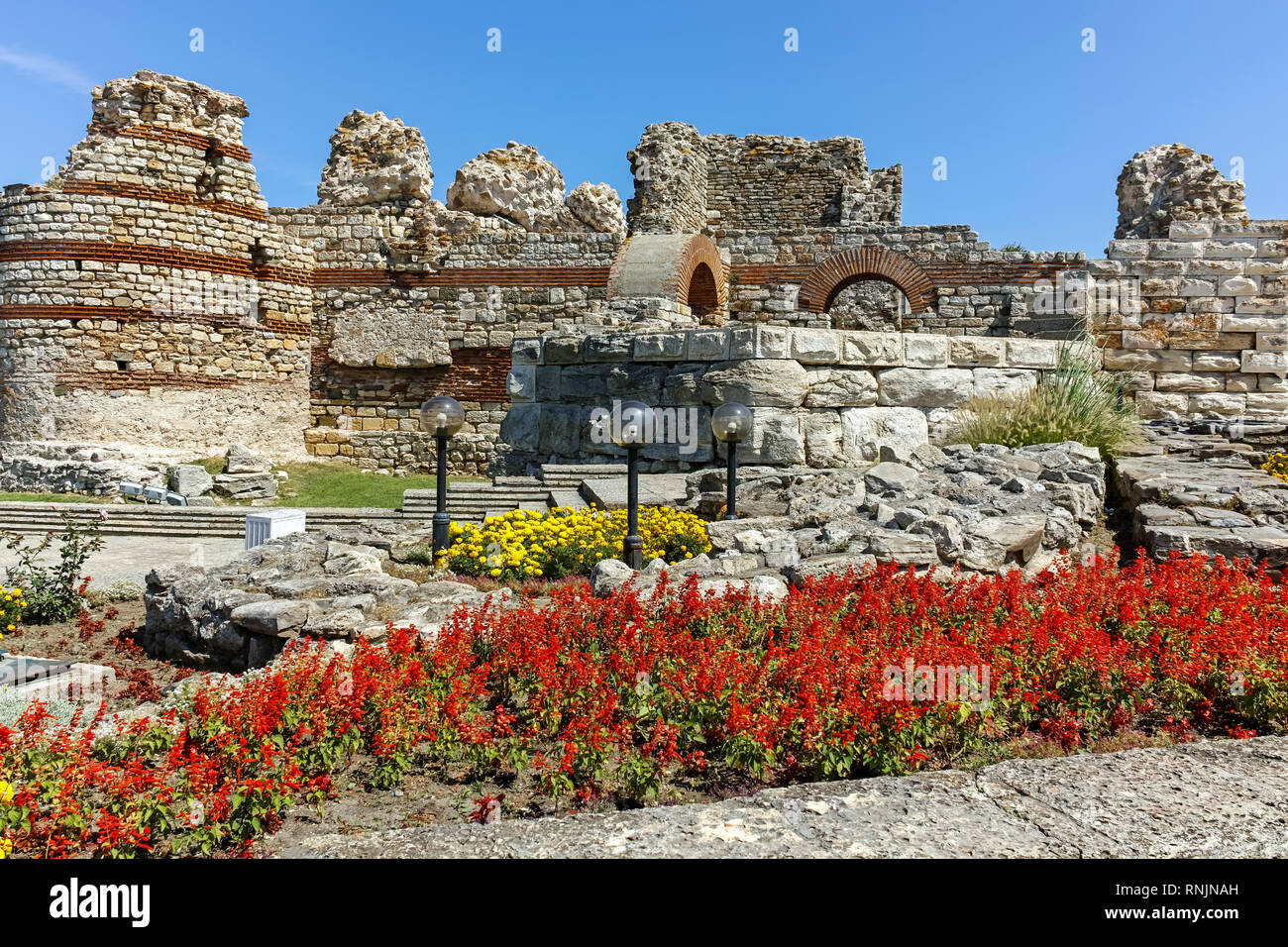 NESSEBAR, BULGARIA - AUGUST 12, 2018: Ancient ruins of Fortifications at the entrance of old town of Nessebar, Burgas Region, Bulgaria - Stock Image