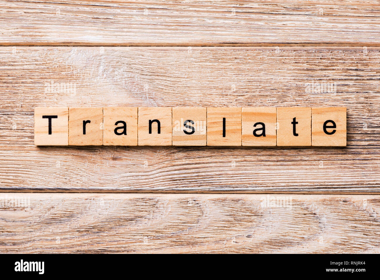 Translate word written on wood block. Translate text on wooden table for your desing, concept. - Stock Image