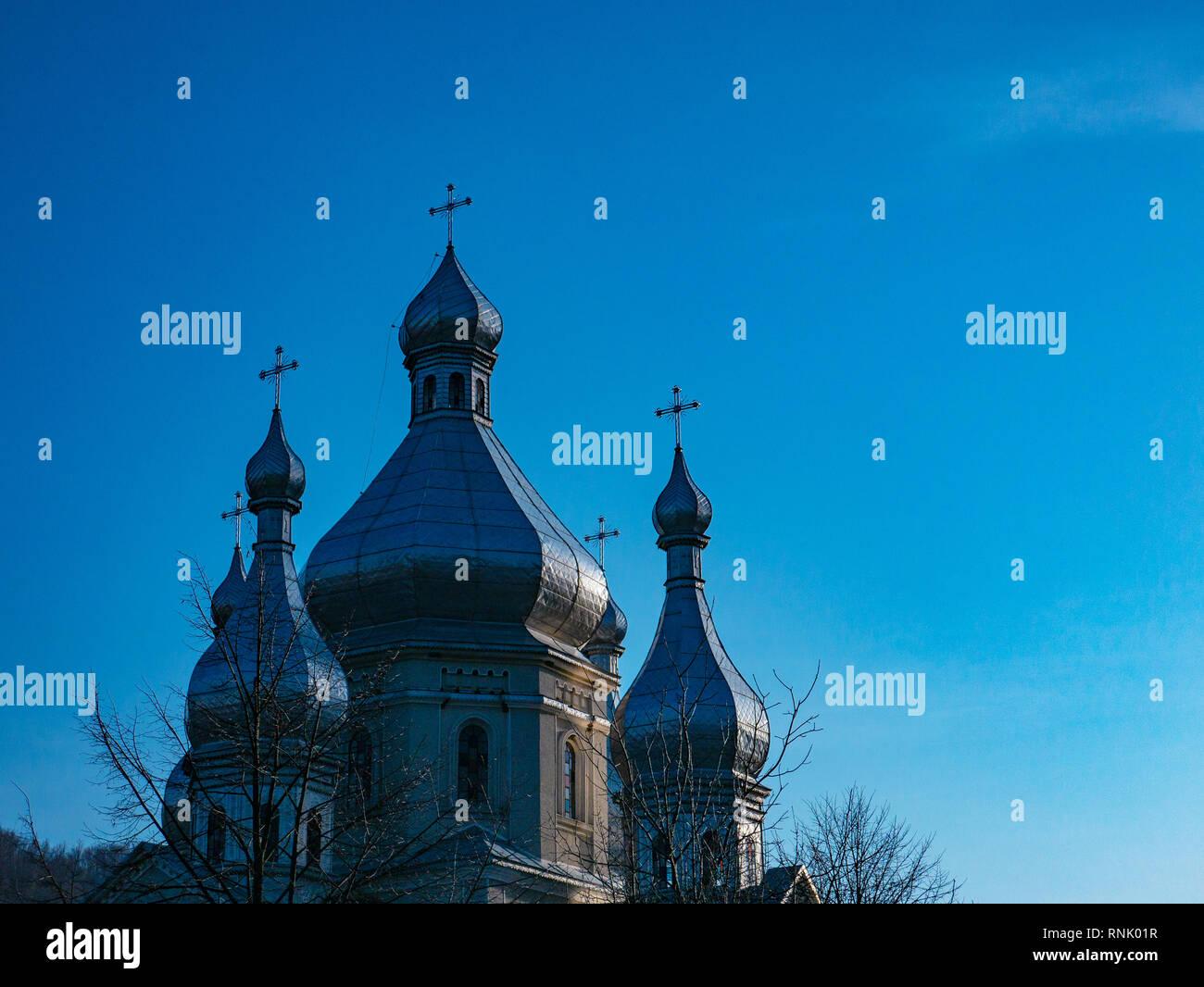 Church in mountain setting. Ukrainian village - Stock Image