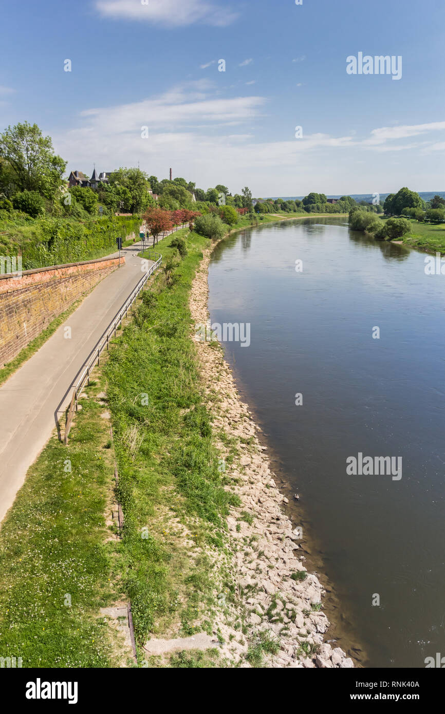 Road along the Weser river near Hoxter, Germany Stock Photo