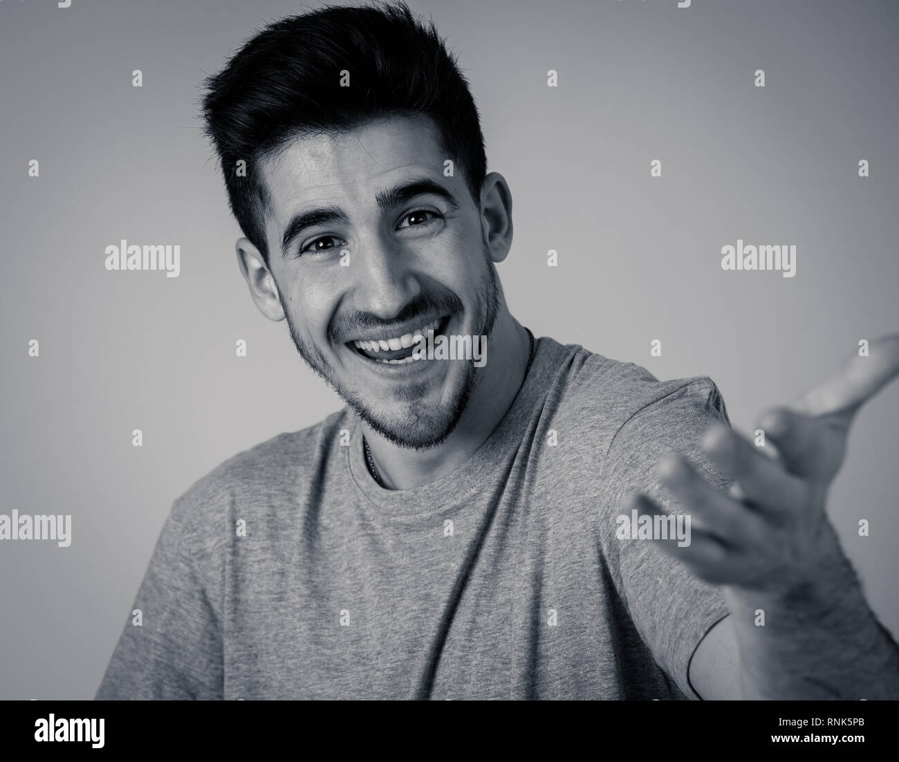 Portrait of young man celebrating achievement, a football goal, wining the lottery or having great success, shouting and gesturing in happiness and di - Stock Image