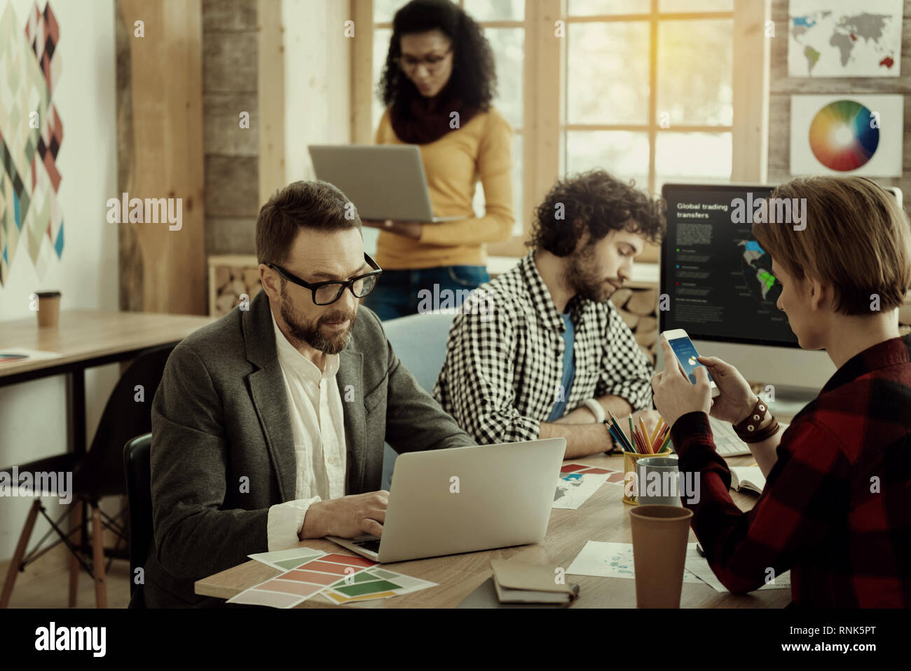 Group of businesspeople working in the office - Stock Image