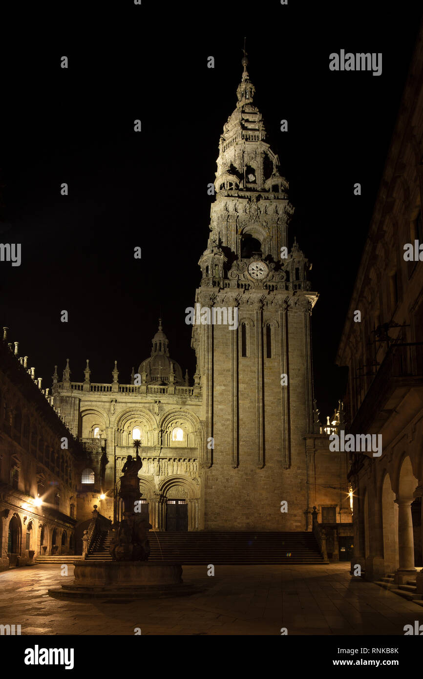 Cathedral of Santiago of Compostela seen from Silversmith Square at night. Plaza de Platerias with Cathedral Clock Tower and Fountain of the Horses vi Stock Photo