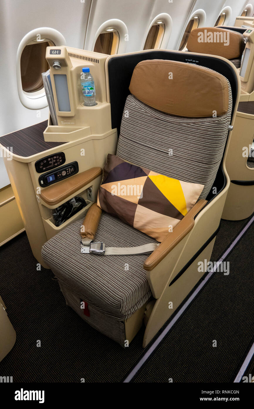 Air Travel, Etihad Airways Boeing 777-300, Business Class cabin, lie-flat bed seat for long-haul flight - Stock Image
