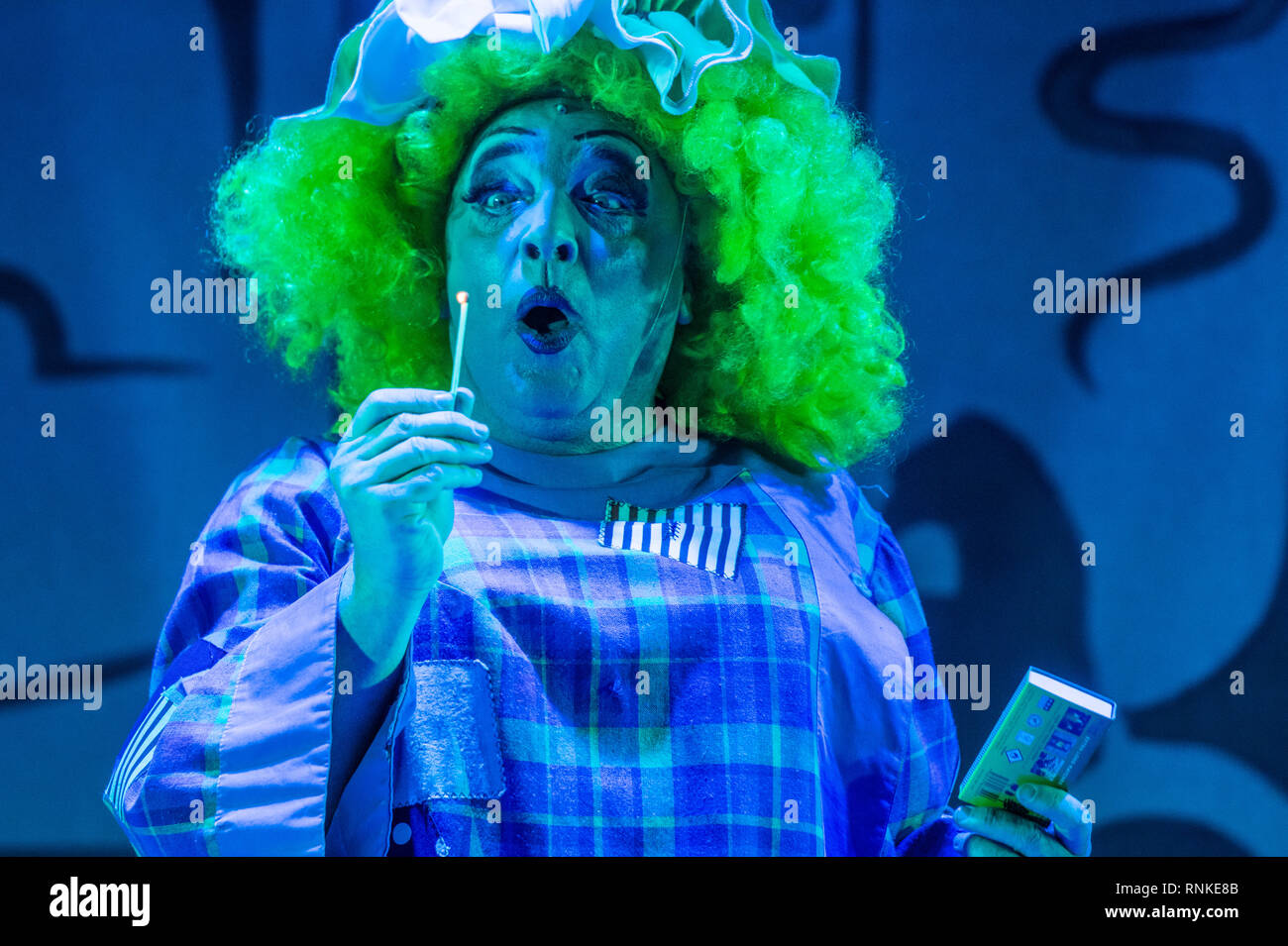 The Pantomime Dame (man dressed as a grotesque caricature of a woman) in an amateur non-professional  local theatre company (The Wardens) performance on stage at Aberystwyth Arts Centree. January 2019 - Stock Photo