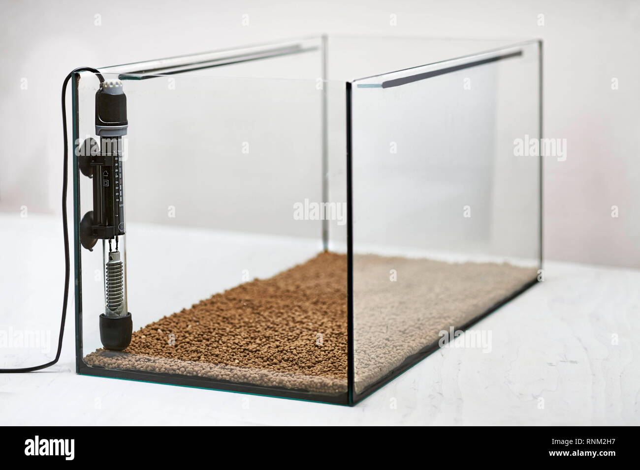 Setting up a fish tank: Safety heater-stat in an empty aquarium - Stock Image