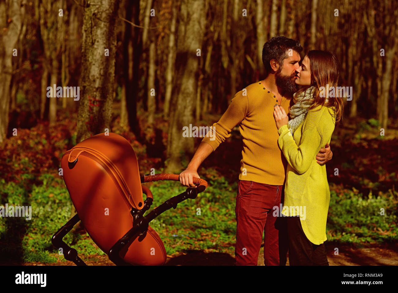 Romantic couple kiss and cuddle in park on spring day. Romantic getaway. Love has no limits - Stock Image