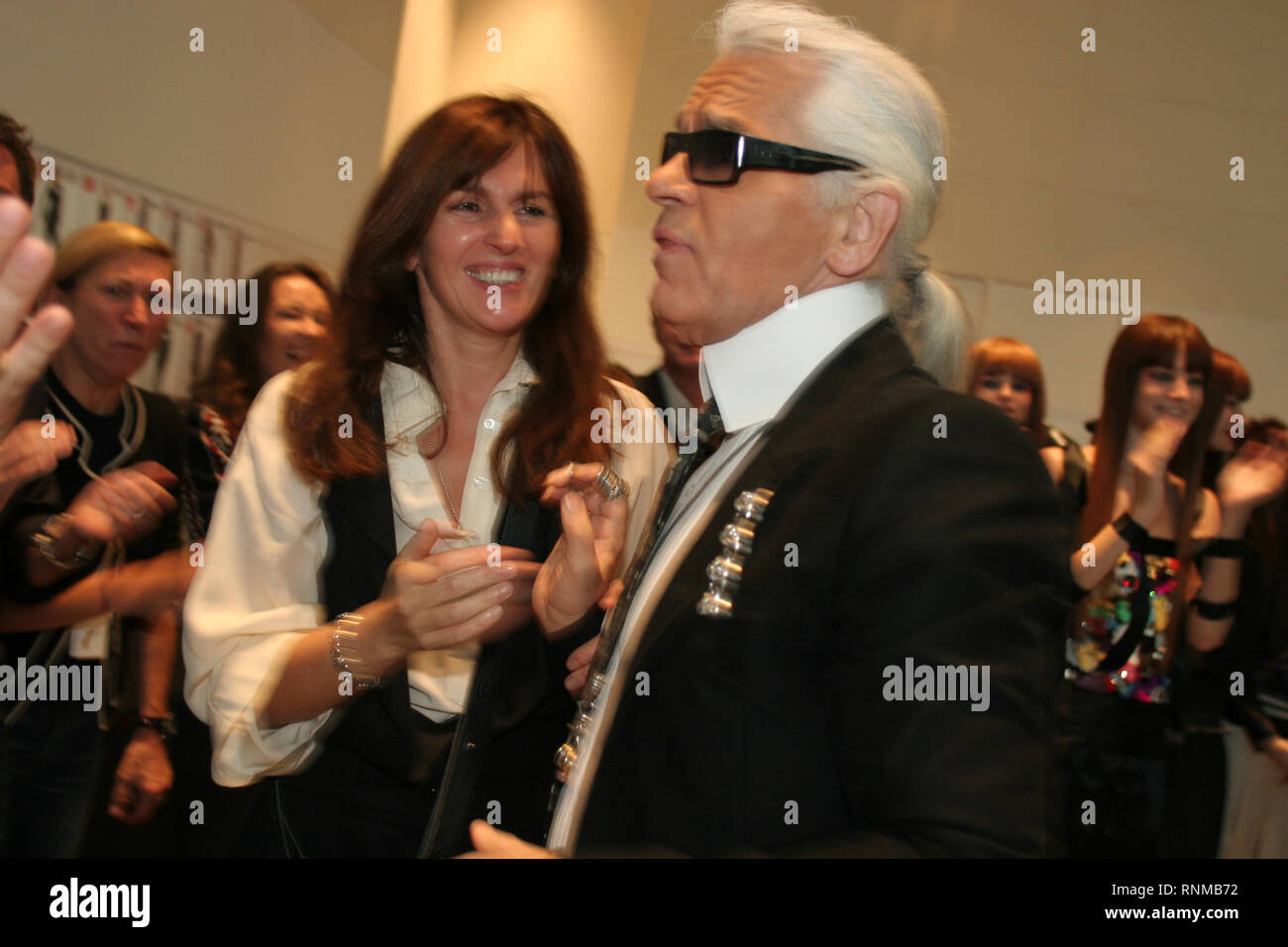 Karl Lagerfeld and models backstage at Chanel 'Coco a Tokyo' fashions shows at the new Chanel store in Ginza, Tokyo, Japan, 03.12.04. The 'Coco a Tokyo' show was the first time Chanel clothes have been premiered outwith Paris, France. Also shots of people shopping in the new store. - Stock Image