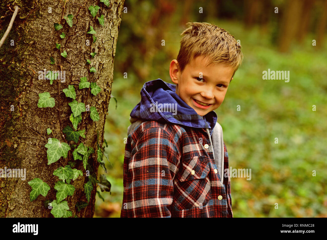 Small boy enjoy childrens day. Small boy play on autumn day. Protecting childrens rights. Every child matters - Stock Image