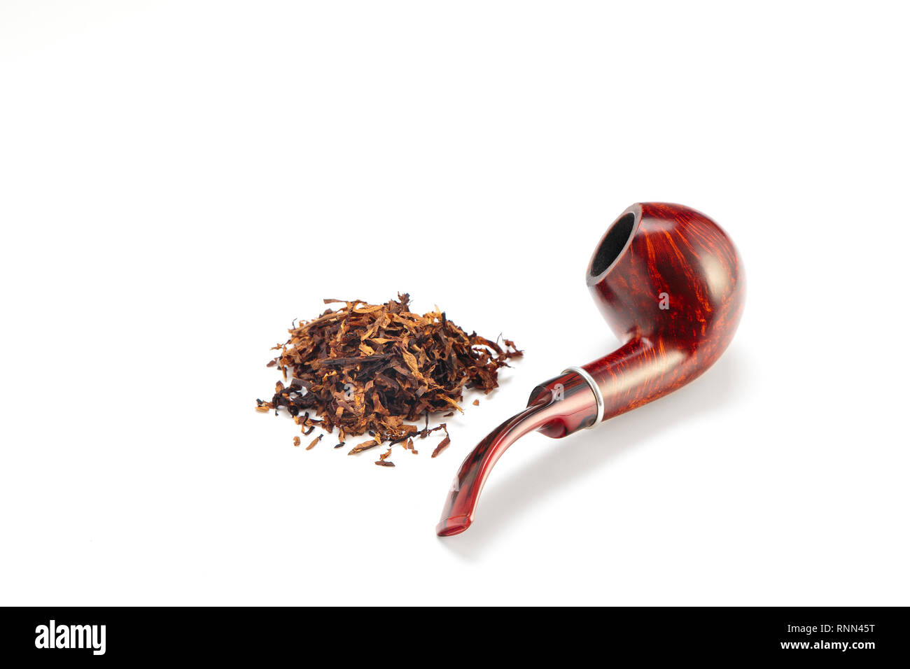 Smoking pipe with quality tobacco leaves on a white background - Stock Image