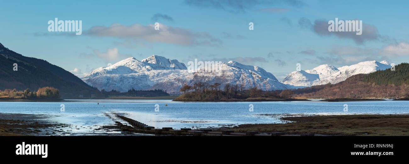 Loch Leven and the mountains to the west of Loch Linnhe from Glencoe village. Eilean Munde is the island in the centre. - Stock Image