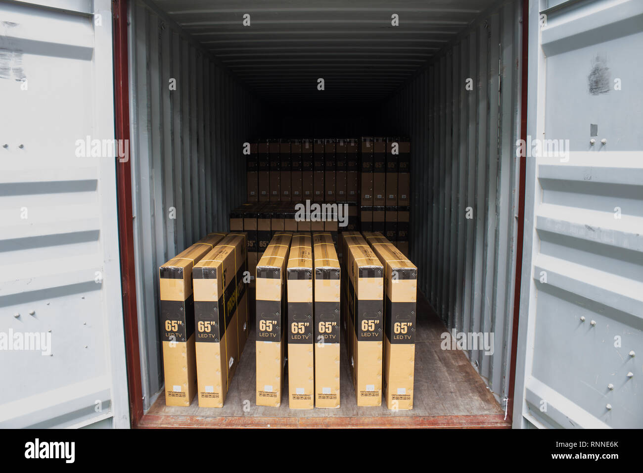 The cartons with loading into of container Stock Photo