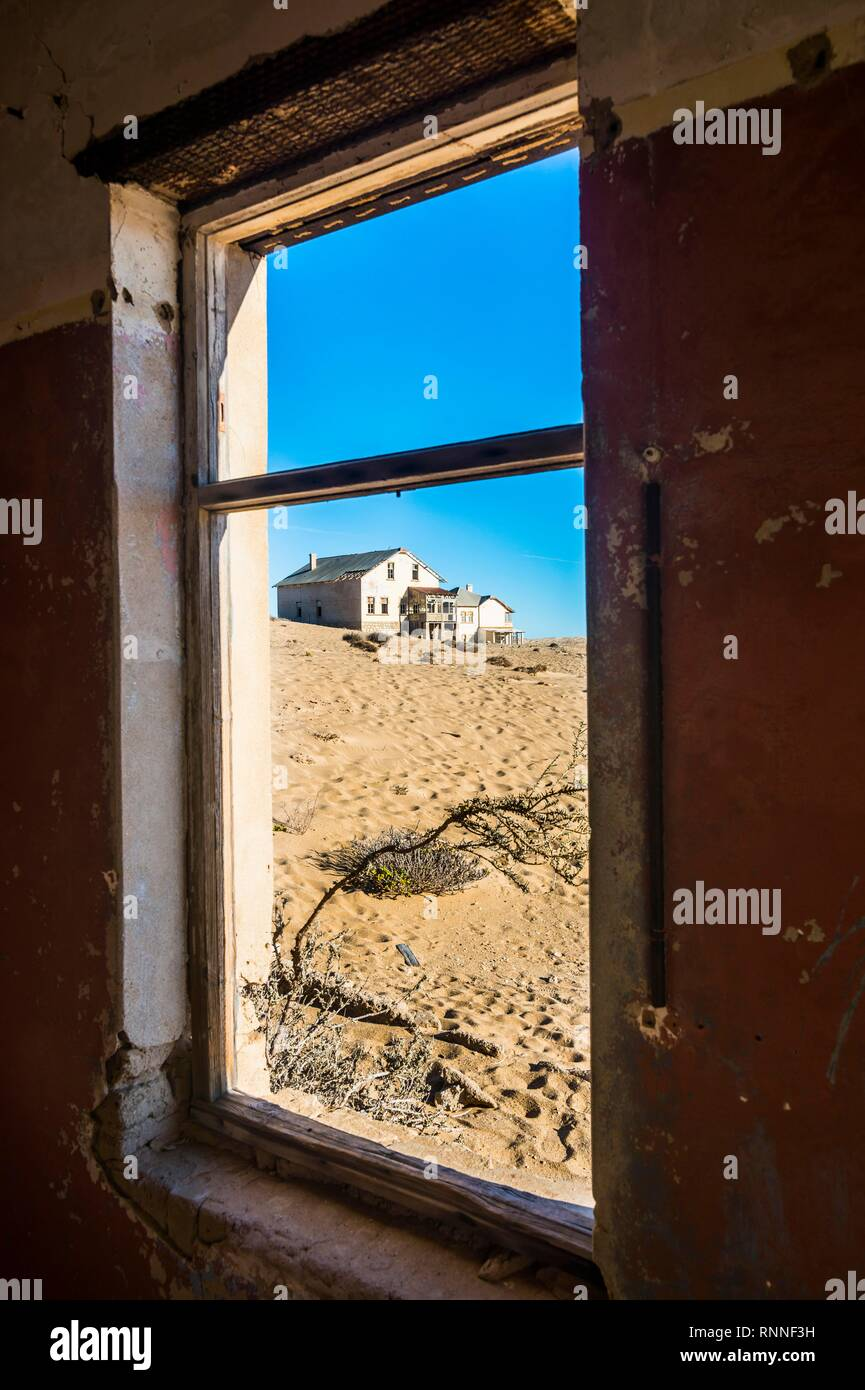 Window of an old colonial house, old mining town Kolmanskop or Coleman's hill, near Lüderitz, Namibia Stock Photo