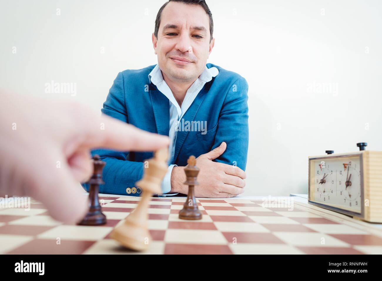 man setting woman checkmate - Stock Image