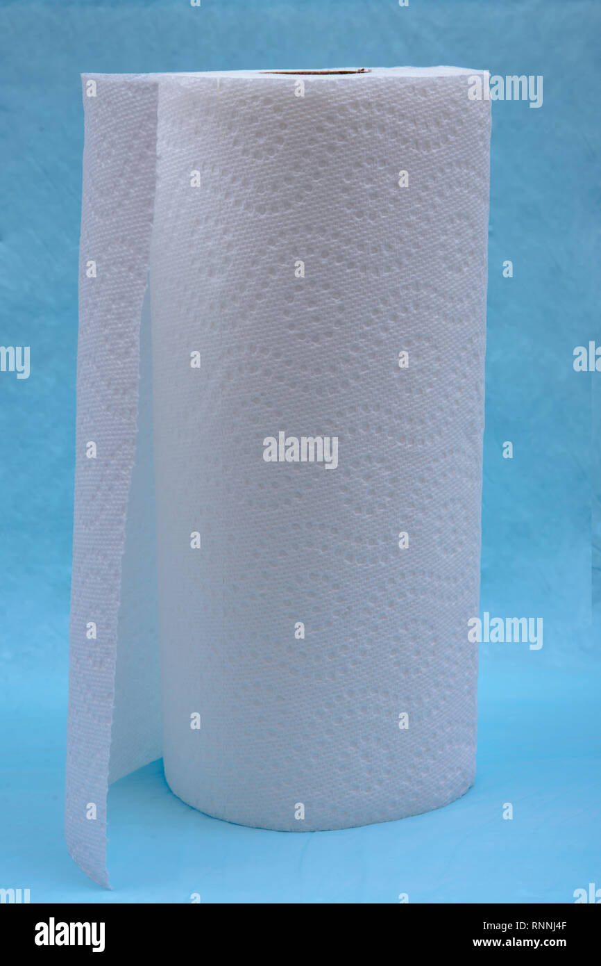 Soft strong and absorbent paper towel isolated on blue under pad. Stock Photo