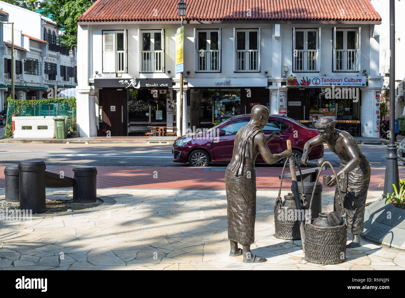Singapore, Chinatown.  Street Sculpture, Corner of Telok Ayer and Boon Tat Streets. - Stock Image