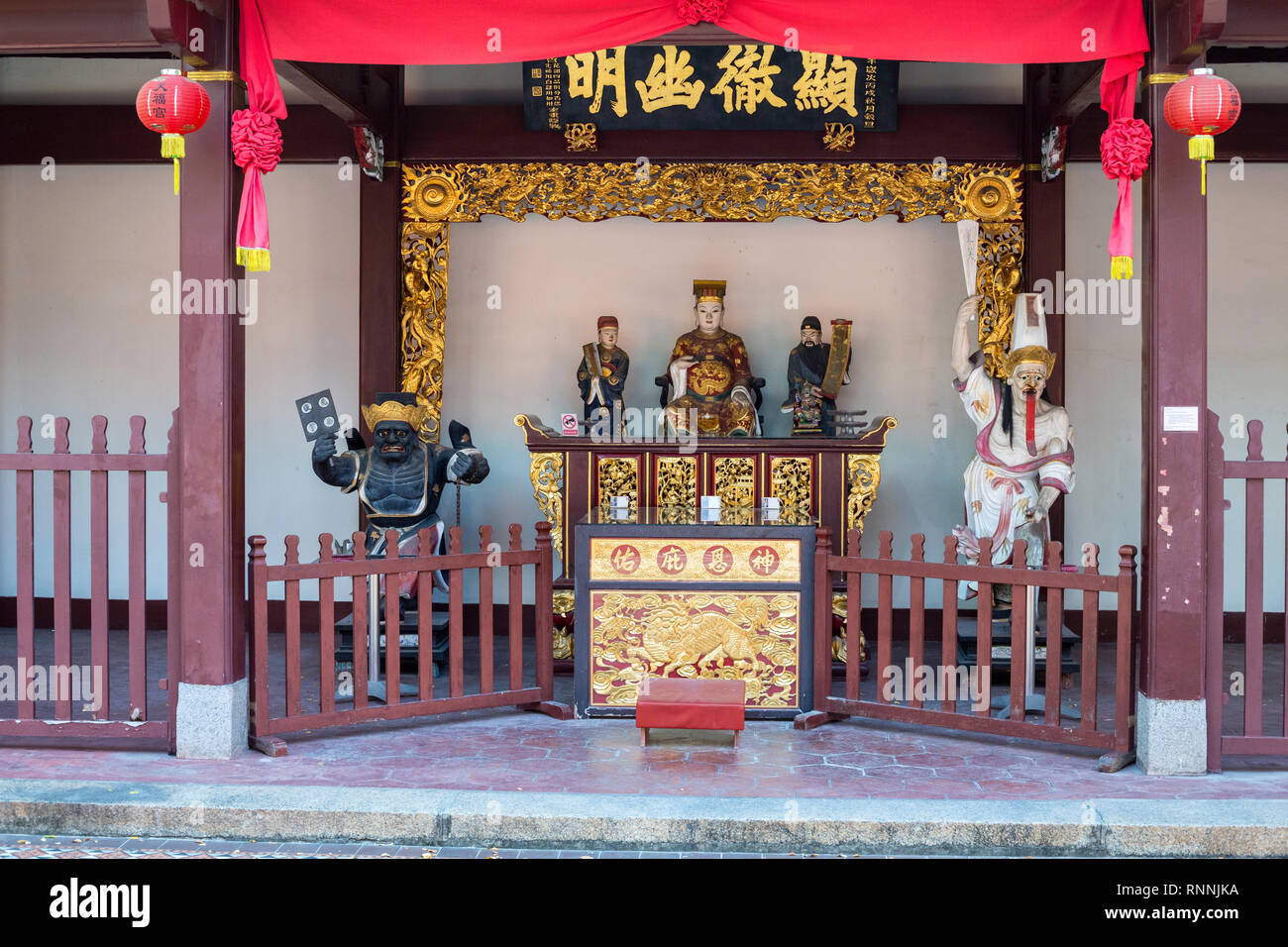 Singapore Thian Hock Keng Taoist Temple, Statue of City Magistrate Cheng Huang, flanked by General Xie on right, General Fan on left. - Stock Image
