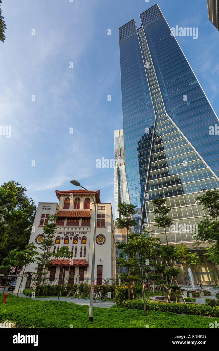 Singapore, Telok Ayer Chinese Methodist Church (1889).  Fraser's Tower Office Building in background. - Stock Image