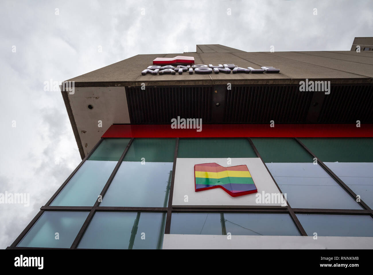 MONTREAL, CANADA - NOVEMBER 5, 2018:  Logo of the National Bank of Canada on their branch for the gay district le Village, with LGBT rainbow flag. Ban - Stock Image