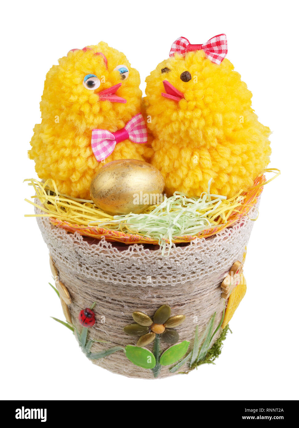Easter handmade  nest from rope and seeds  with funny chickens and golden egg. Isolated on white studio macro shot Stock Photo