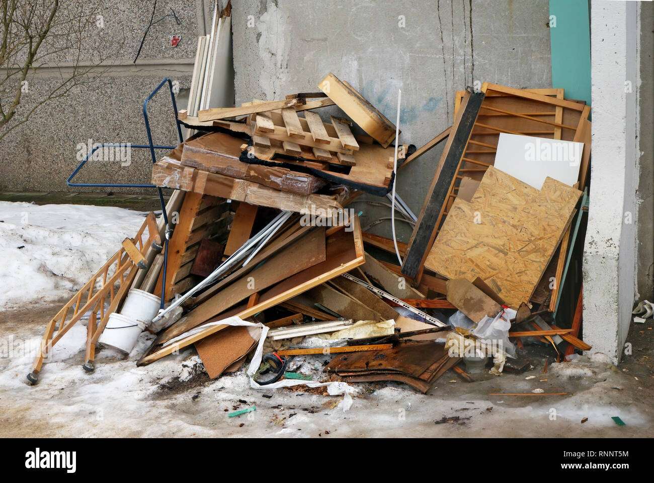 Boards and old furniture at the garbage dump near the