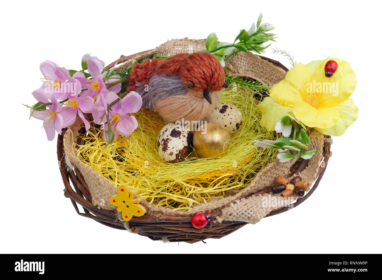Easter handmade  nest from birch twigs  with funny sparrow bird  and quail eggs. Isolated on white studio macro shot Stock Photo