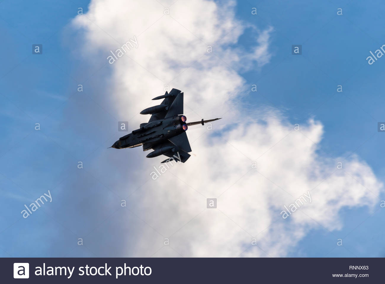 Three Panavia Tornado GR4 fighter jets have begun their farewell tour of the UK prior to the veteran aircraft going out of service with the RAF. A Tornado breaks into the circuit after the flight - Stock Image