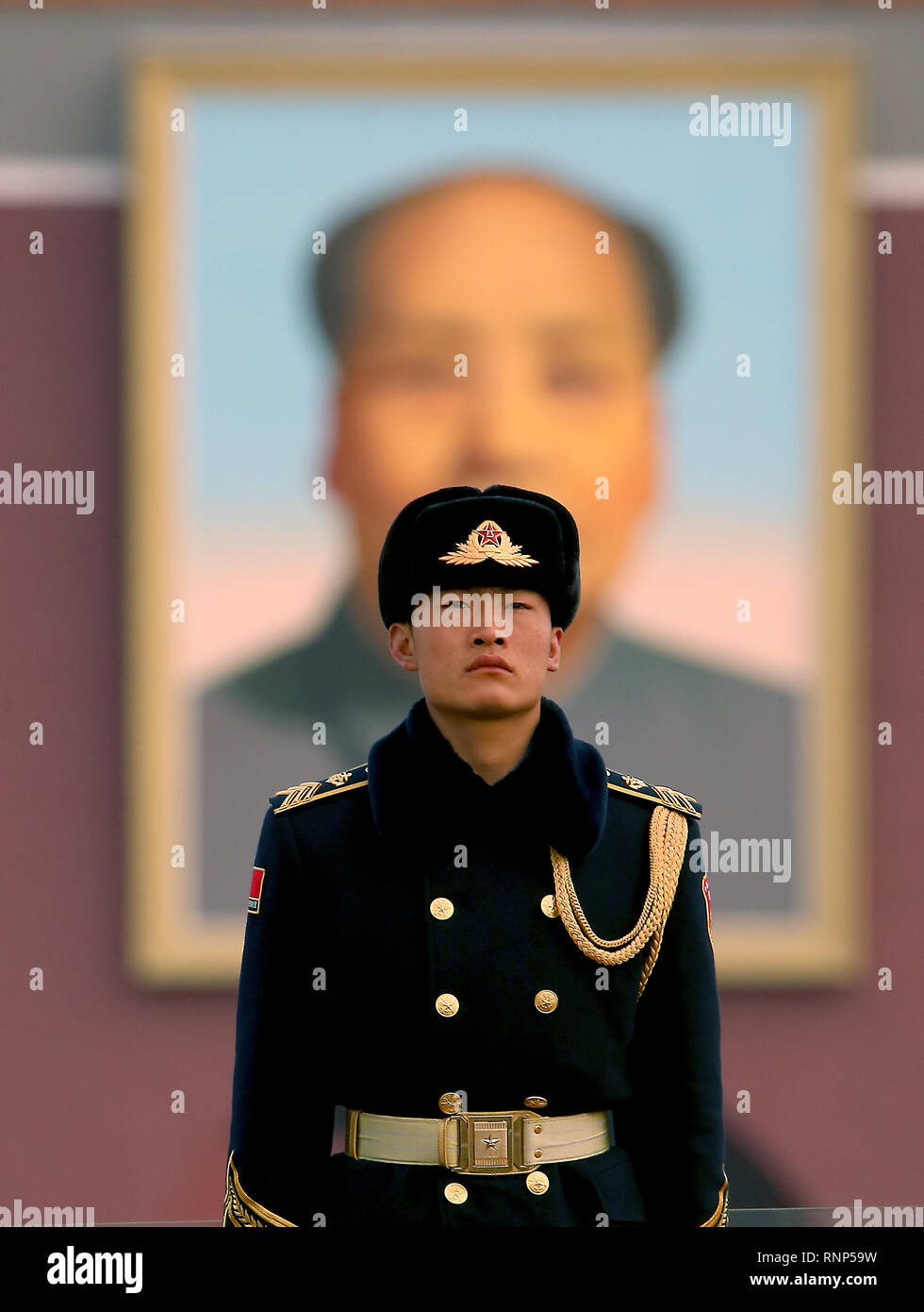 Beijing, China. 5th Mar, 2018. A Chinese soldier stands guard in Tiananmen Square in front of a giant portrait of former helmsman Mao Zedong as the annual National People's Congress opens in Beijing on March 5, 2018. China's largely ceremonial parliament opened Monday, with over 3,000 delegates poised to endorse controversial measures that will allow Chinese President Xi Jinping to rule indefinitely. Credit: Todd Lee/ZUMA Wire/ZUMAPRESS.com/Alamy Live News - Stock Image