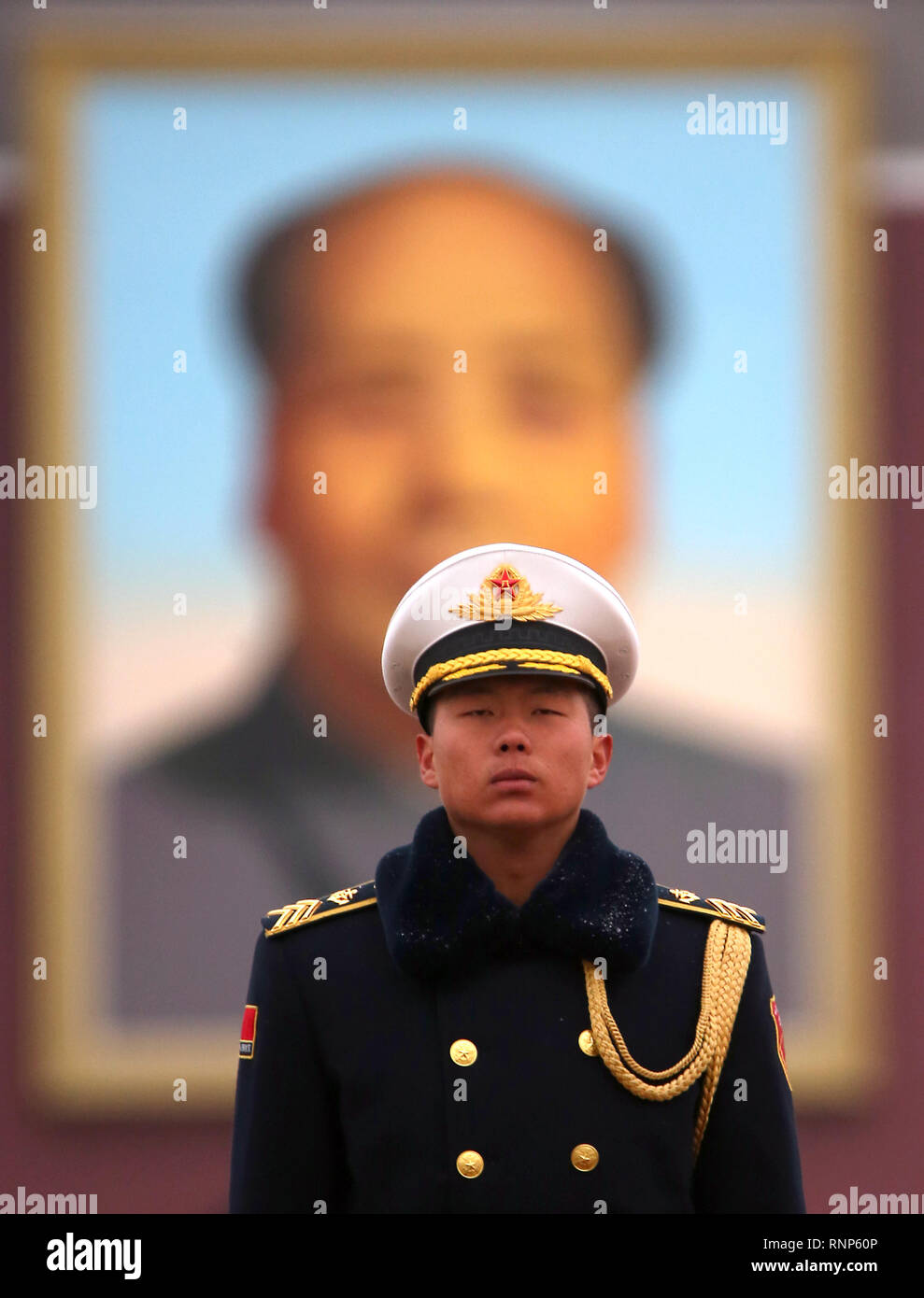 Beijing, China. 17th Mar, 2018. A Chinese soldier stands guard on Tiananmen Square in front of large portrait of former helmsman Mao Zedong as the National People's Congress continues in the Great Hall of the People in Beijing on March 17, 2018. Chinese President Xi Jinping has secured another five years as China's leader. Credit: Todd Lee/ZUMA Wire/ZUMAPRESS.com/Alamy Live News - Stock Image