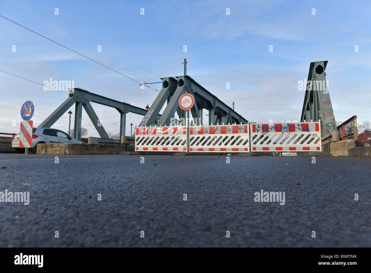 Berlin, Germany. 20th Feb, 2019. Barrier grids are still standing on the Salvador Allende Bridge in Köpenick. A power cable was damaged there during construction work yesterday. Since Tuesday (19.02.2019), the Köpenick district has been cut off from the electricity supply, affecting more than 30,000 households and 2,000 commercial enterprises. Credit: Wolfgang Kumm/dpa/Alamy Live News - Stock Image