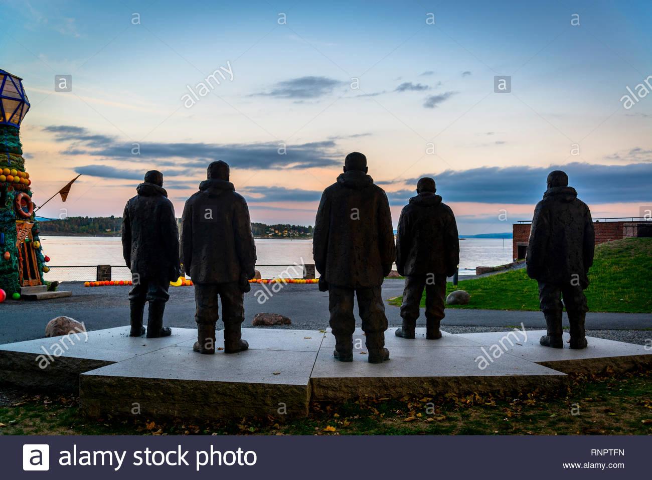 Sculptures of maritime explorers facing the Oslofjord near Norwegian Maritime Museum, Bygdoy peninsula, Oslo, Norway - Stock Image