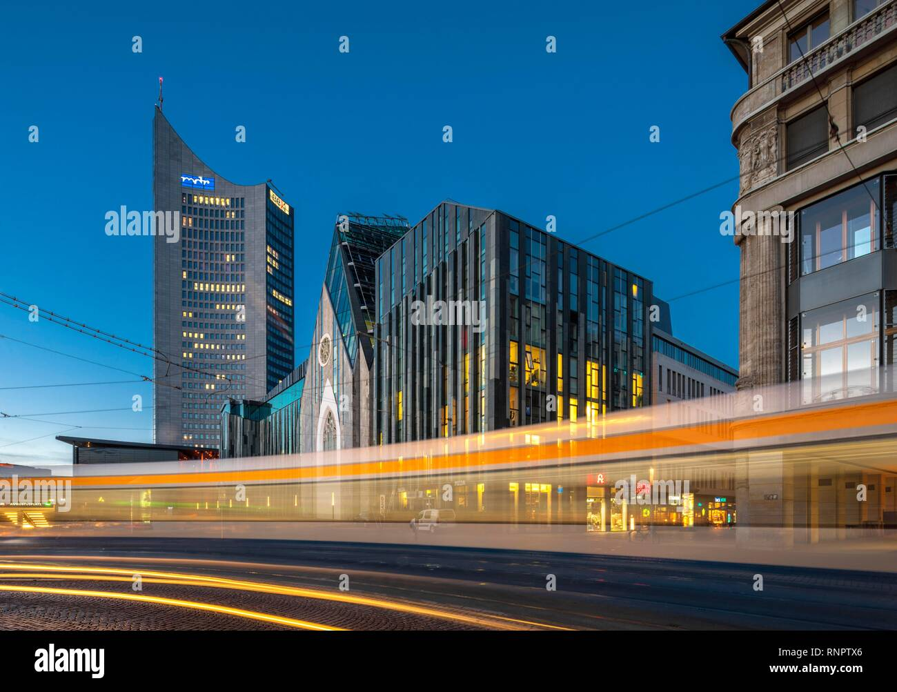 Augustusplatz with City Tower, University Buildings Augusteum and Paulinum, Tram Light Tracks, University of Leipzig, Saxony - Stock Image