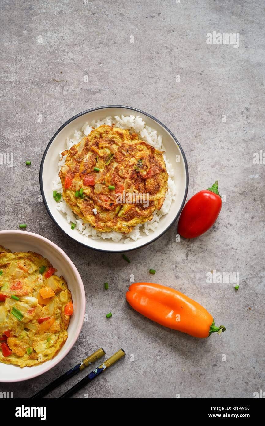 Egg Foo Young served with Jasmine rice - Stock Image