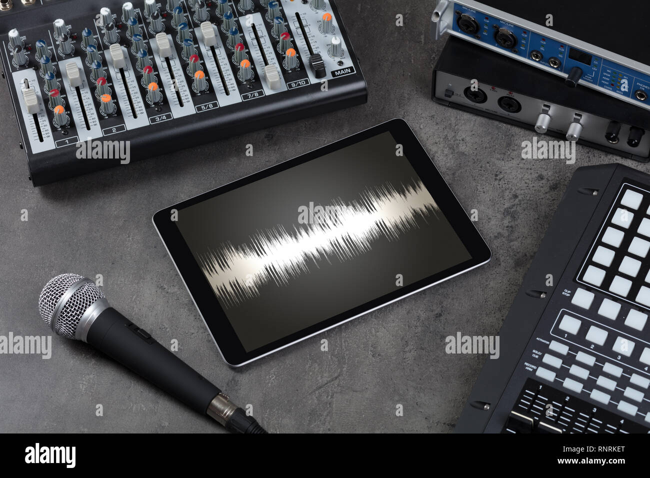 Recording music with tablet and electronic music instruments   - Stock Image