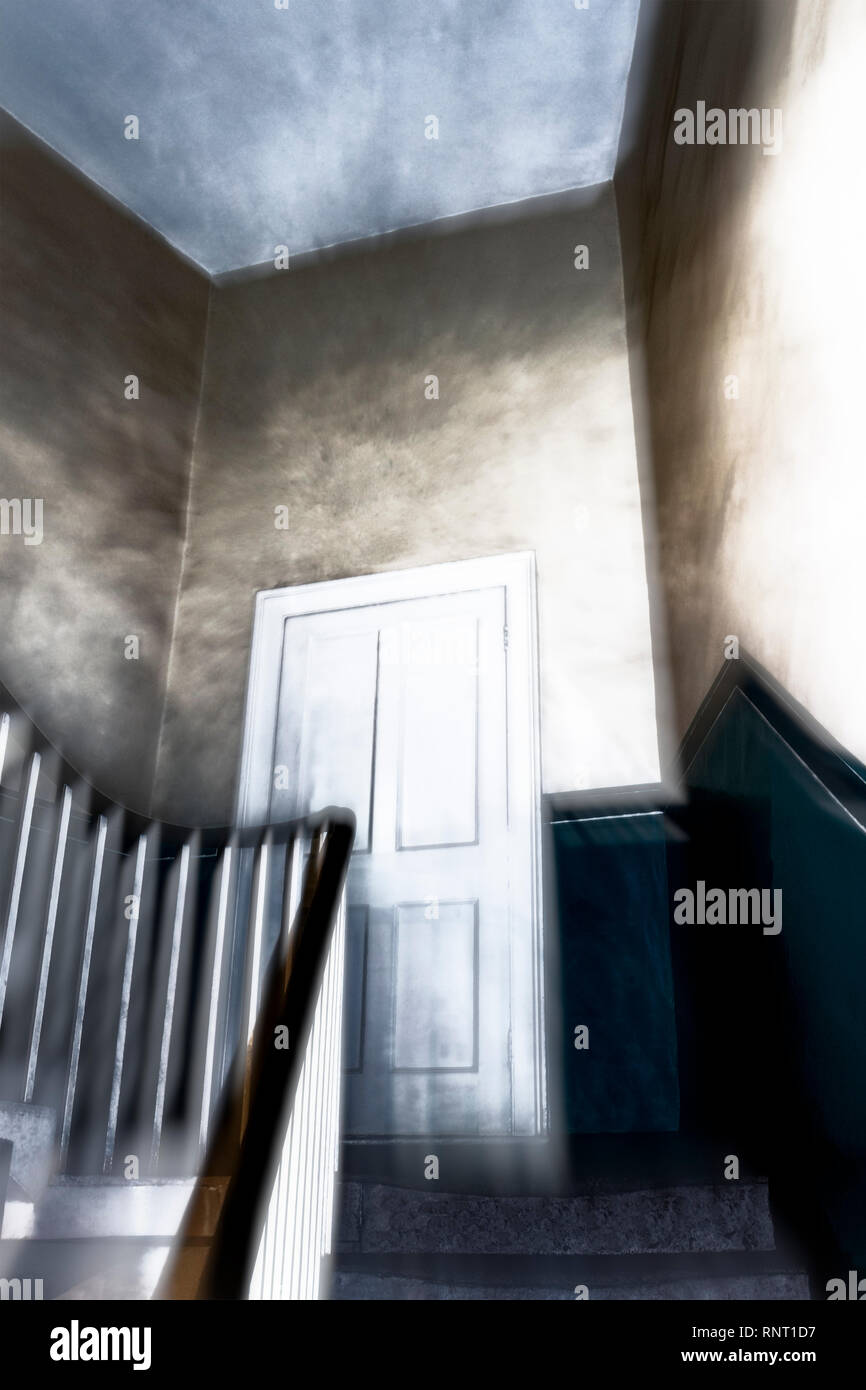 A stylised and atmospheric image of door on the half landing of a spooky staircase in a Victorian house - Stock Image