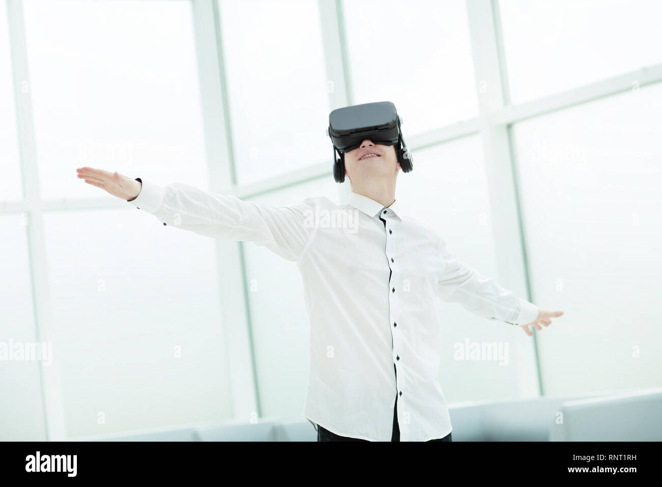 young men testing virtual reality glasses in office - Stock Image