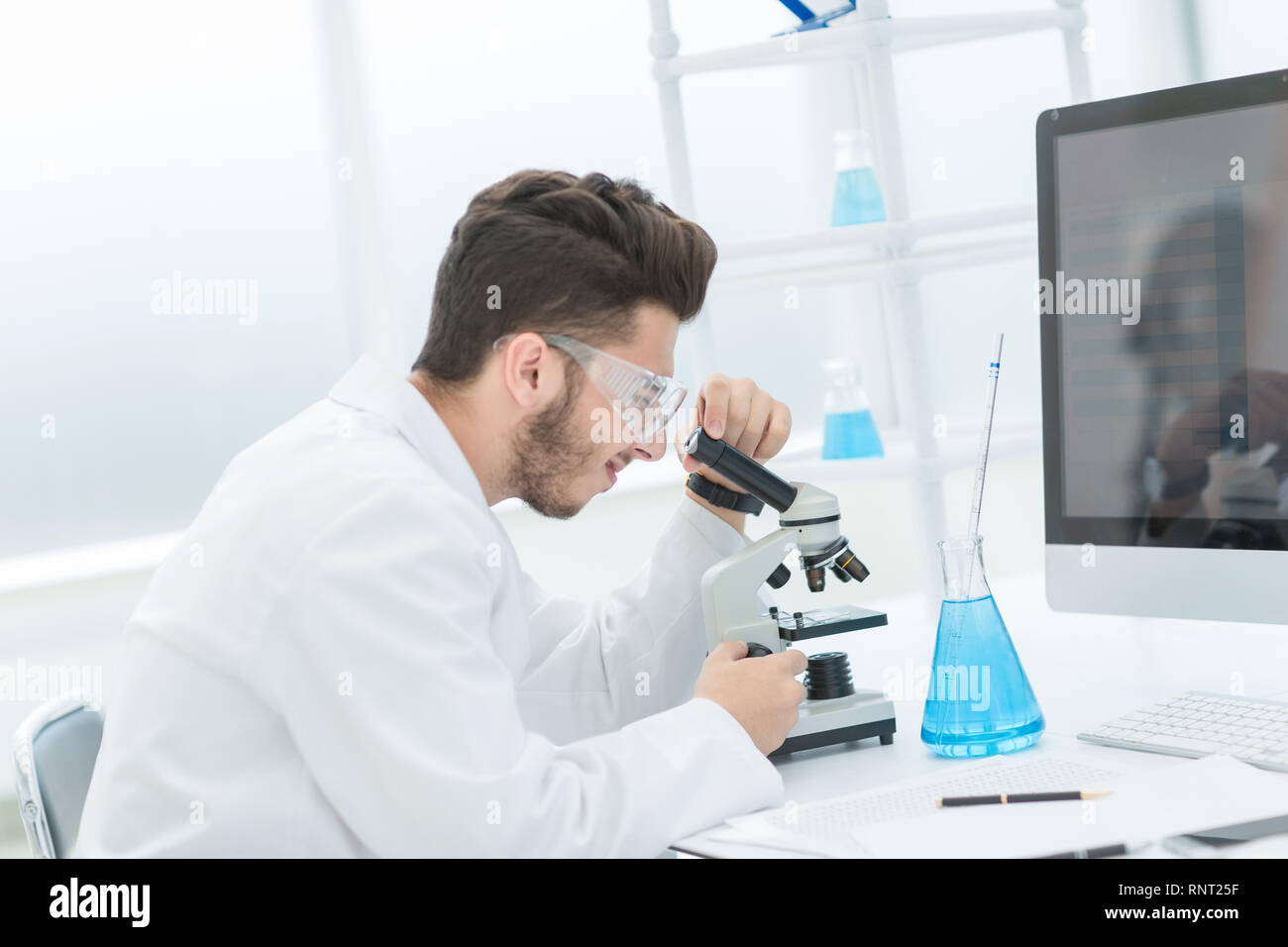 modern scientist conducts research in the laboratory - Stock Image