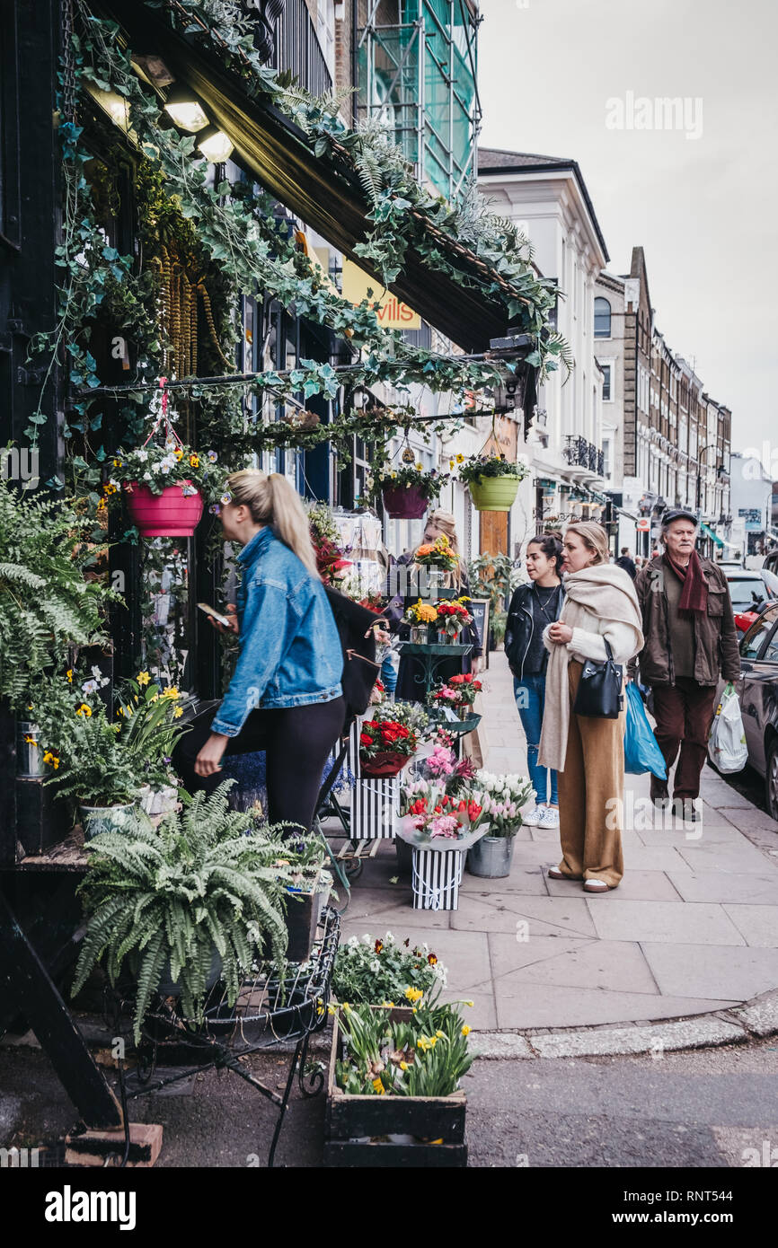 London, UK - February 16, 2019: People by the The Fitzroy's Flowers Collection florist in Primrose Hill, an upscale area of North London that got its  - Stock Image