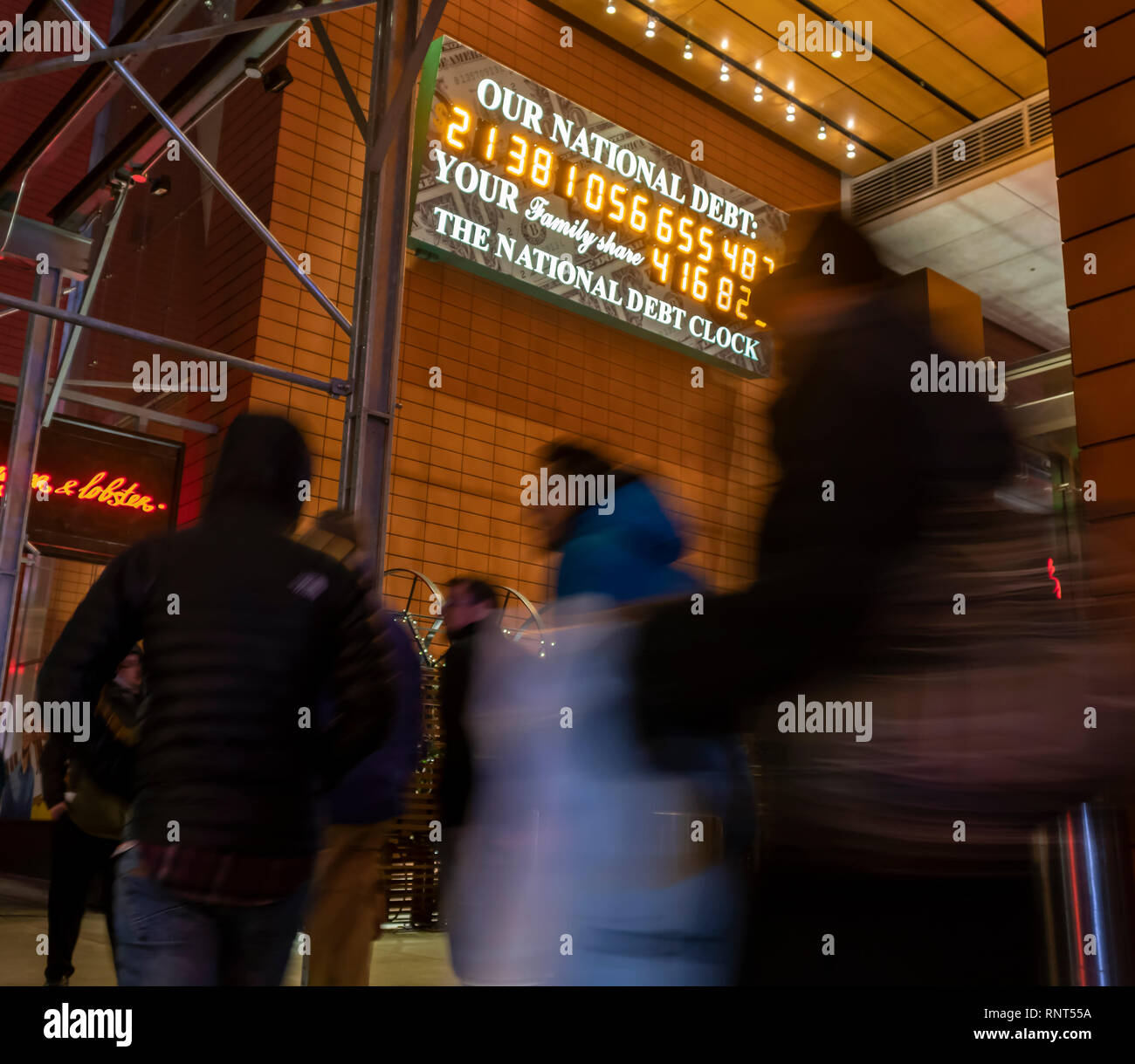 The National Debt Clock is seen in New York on Wednesday, February 13, 2019. Despite the clock being out of sync, the U.S. Treasury Dept. reported that the U.S. National Debt has surpassed $22 trillion. (© Richard B. Levine) - Stock Image