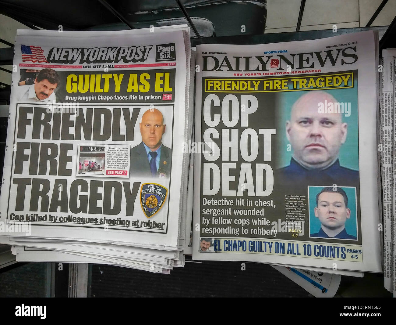 Headlines of the New York Daily News and the New York Post on Wednesday, February 13, 2019 report on the death of NYPD Detective Brian Simonsen by friendly fire during a previous day's robbery of a T-Mobile store in Richmond Hill, Queens. (© Richard B. Levine) - Stock Image