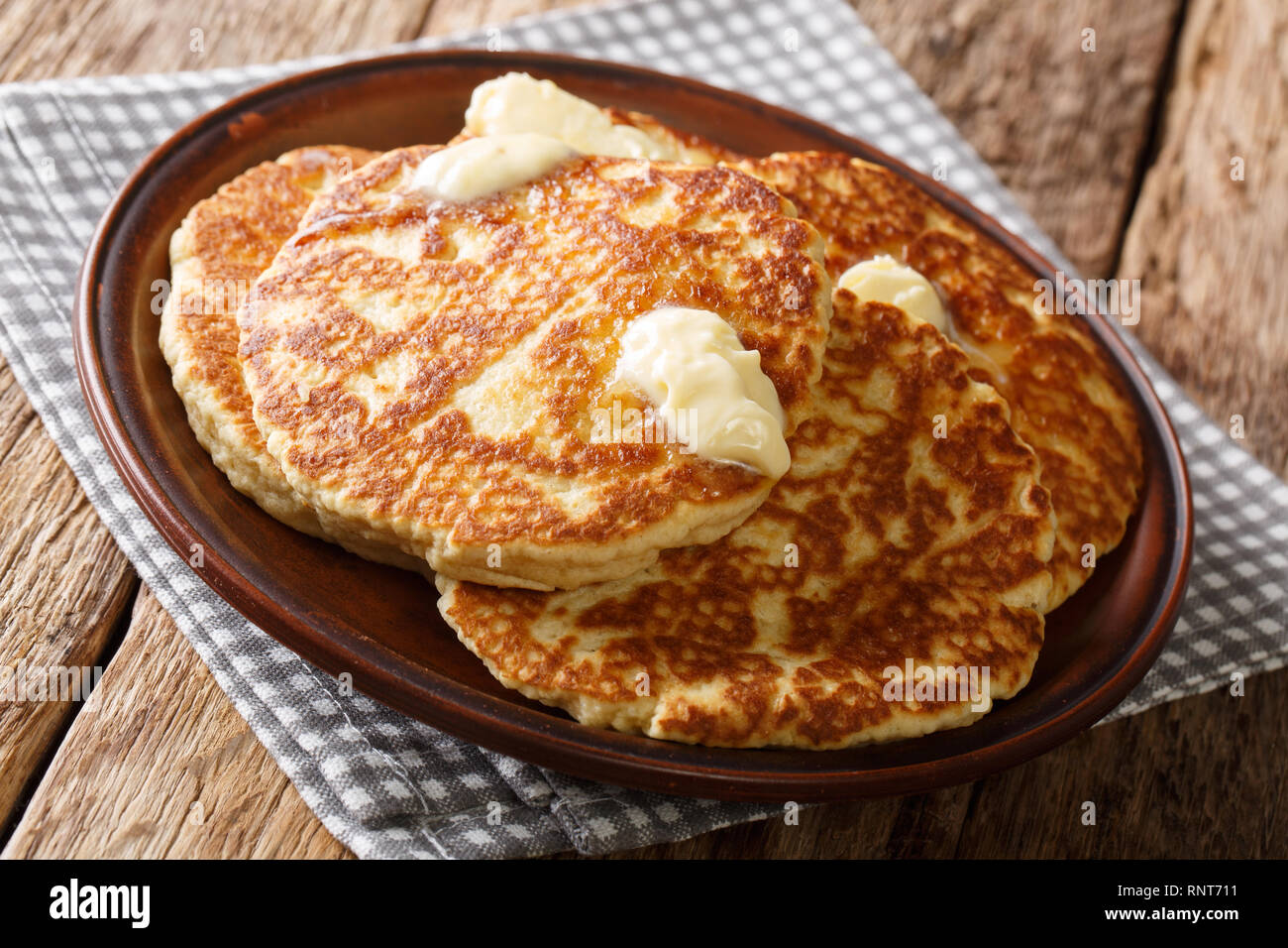 Homemade Gorditas de Azucar Sweet Griddle Cakes with butter close-up on a plate on the table. horizontal - Stock Image