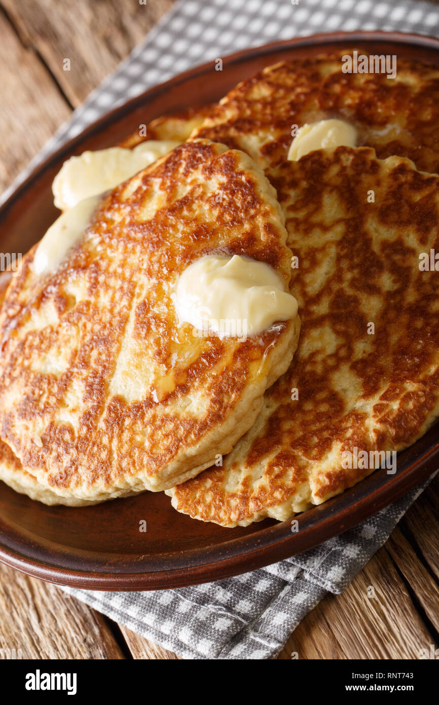 Gorditas de Azucar (Sweet Griddle Cakes) with butter close-up on a plate on the table. vertical - Stock Image