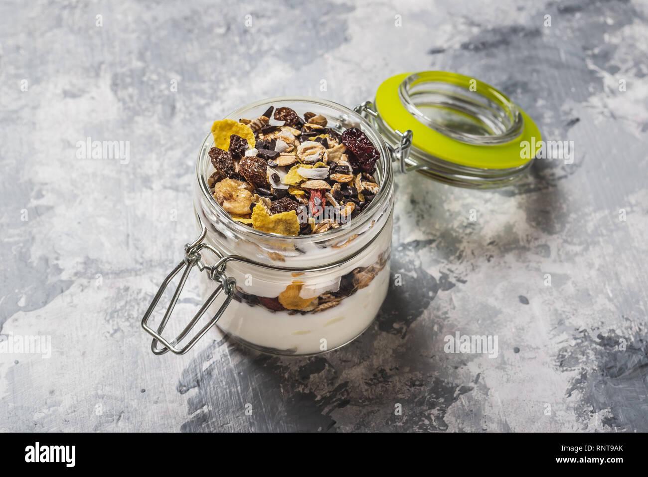 Horizontal photo of white yogurt  Yogurt is in small glass