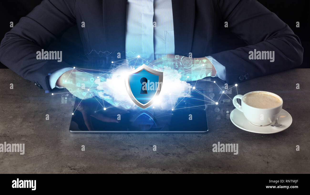 Business woman working on tablet with secured cloud technology and network concept  - Stock Image