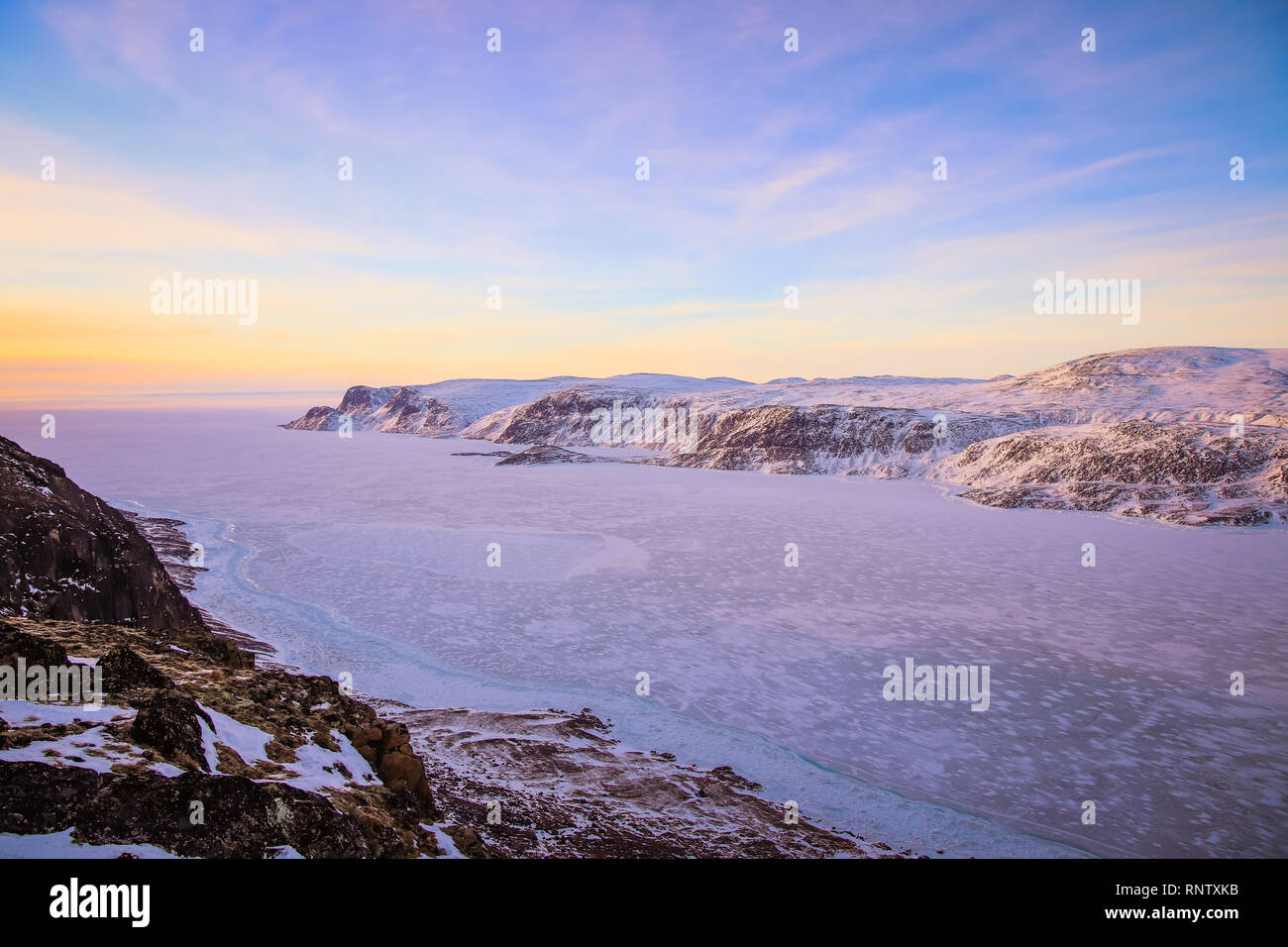 From behind the village Pangnirtung is a mountain with views of the surrounding fiord out to the Cumberland Sea. - Stock Image
